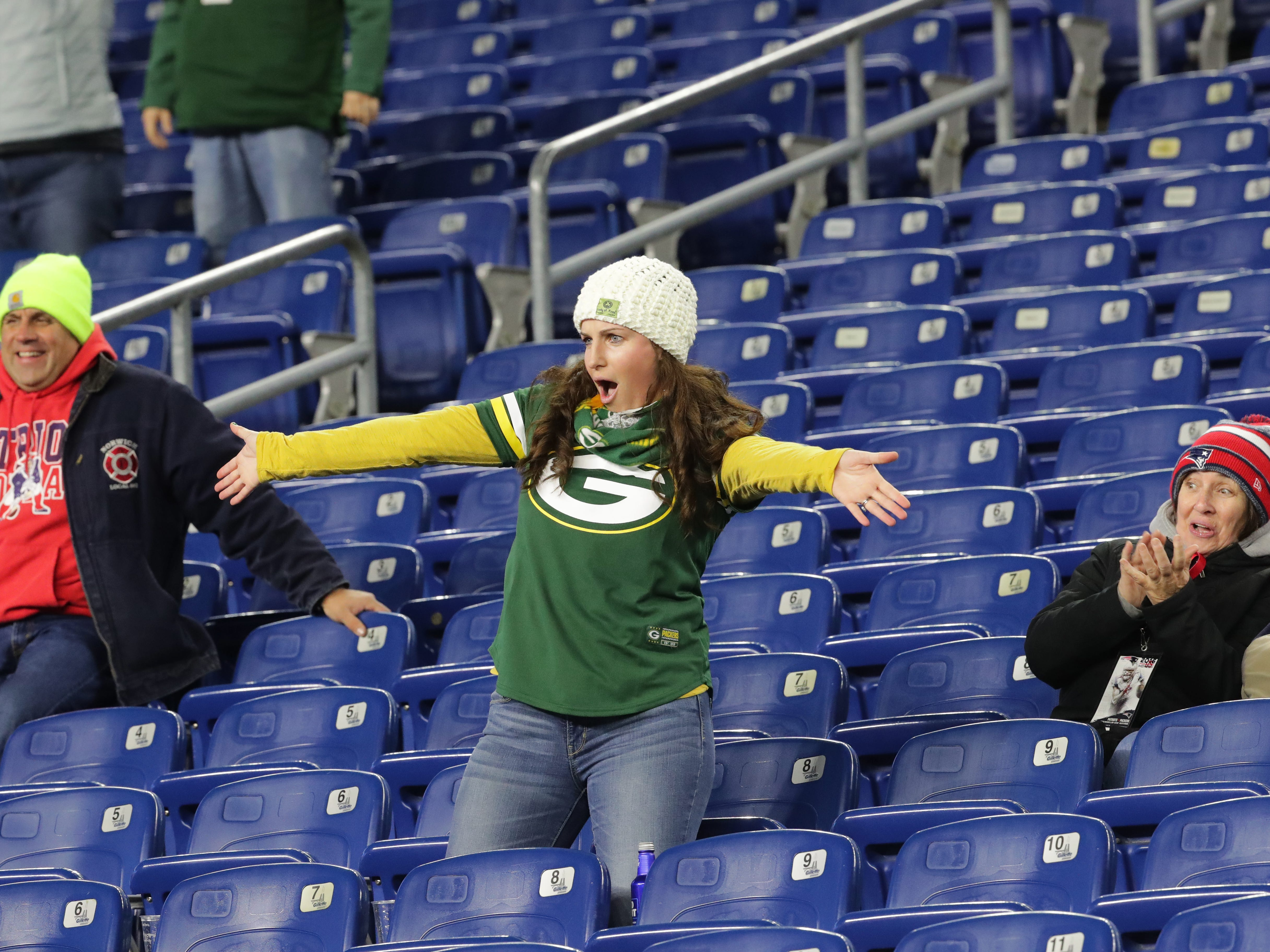 Samantha Winfrey reacts after throwing a football back Green Bay Packers running back Jamaal Williams before their game against the New England Patriots Sunday, November 4, 2018 at Gillette Stadium in Foxborough, Mass. She is from Westerly, R.I.