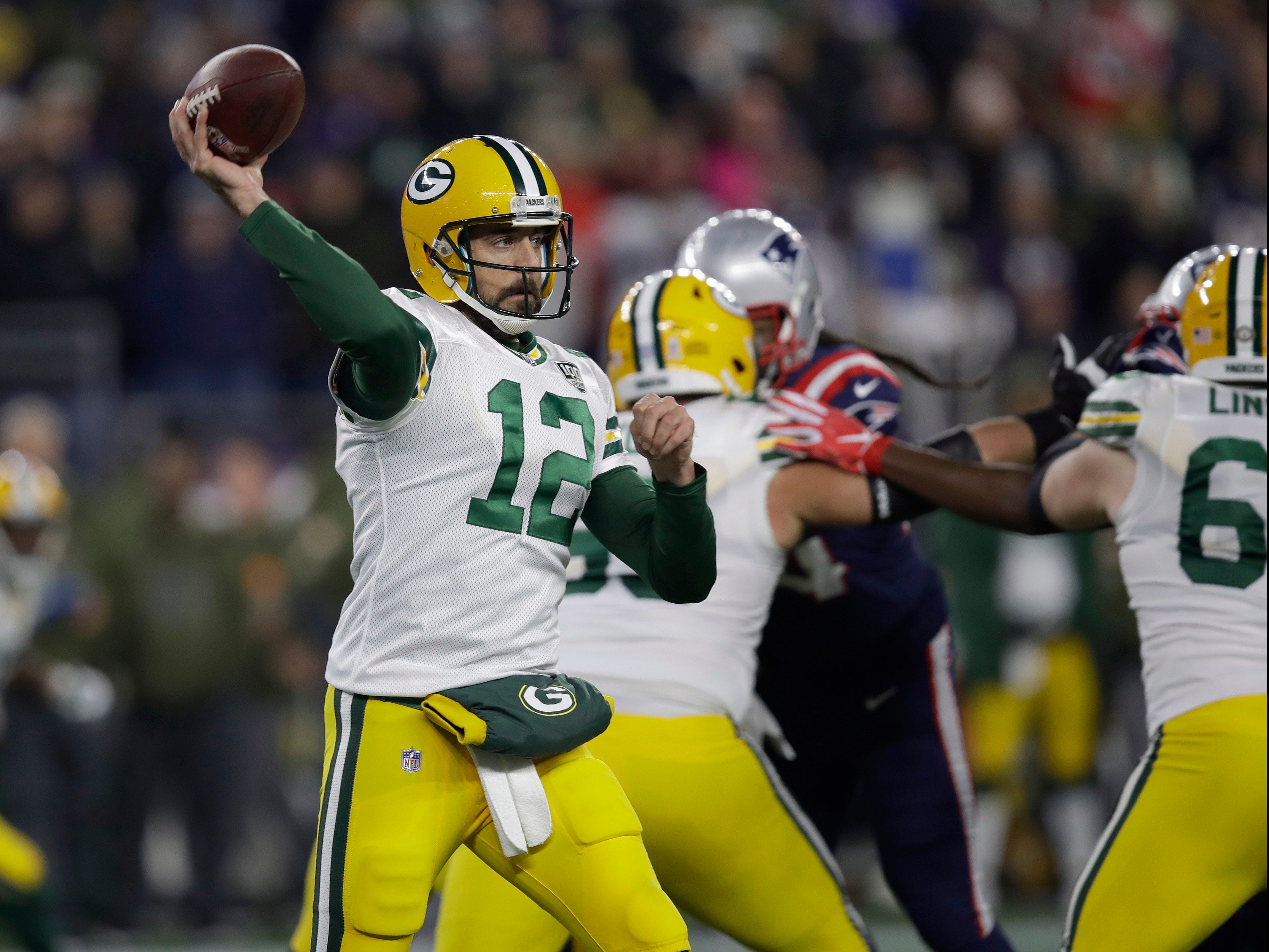 Green Bay Packers quarterback Aaron Rodgers passes against the New England Patriots during the first half of an NFL football game, Sunday, Nov. 4, 2018, in Foxborough, Mass. (AP Photo/Charles Krupa)