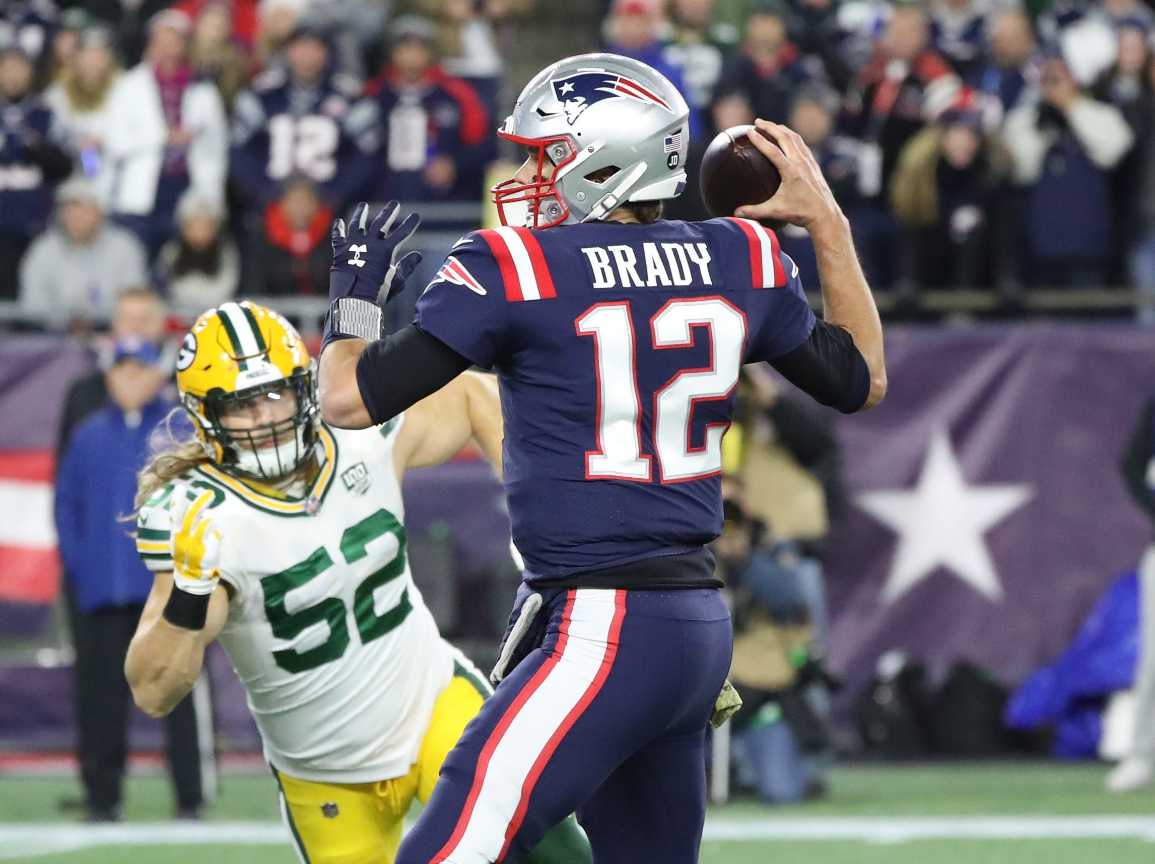 Green Bay Packers outside linebacker Clay Matthews (52) tries to pressure quarterback Tom Brady (12) against the New England Patriots Sunday, November 4, 2018 at Gillette Stadium in Foxborough, Mass.