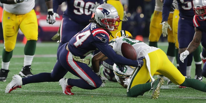 New England Patriots cornerback Stephon Gilmore (24) recovers a fumble by Green Bay Packers running back Aaron Jones (33) during the fourth quarter of their game Sunday, November 4, 2018 at Gillette Stadium in Foxborough, Mass. The New England Patriots beat the Green Bay Packers 31-17.