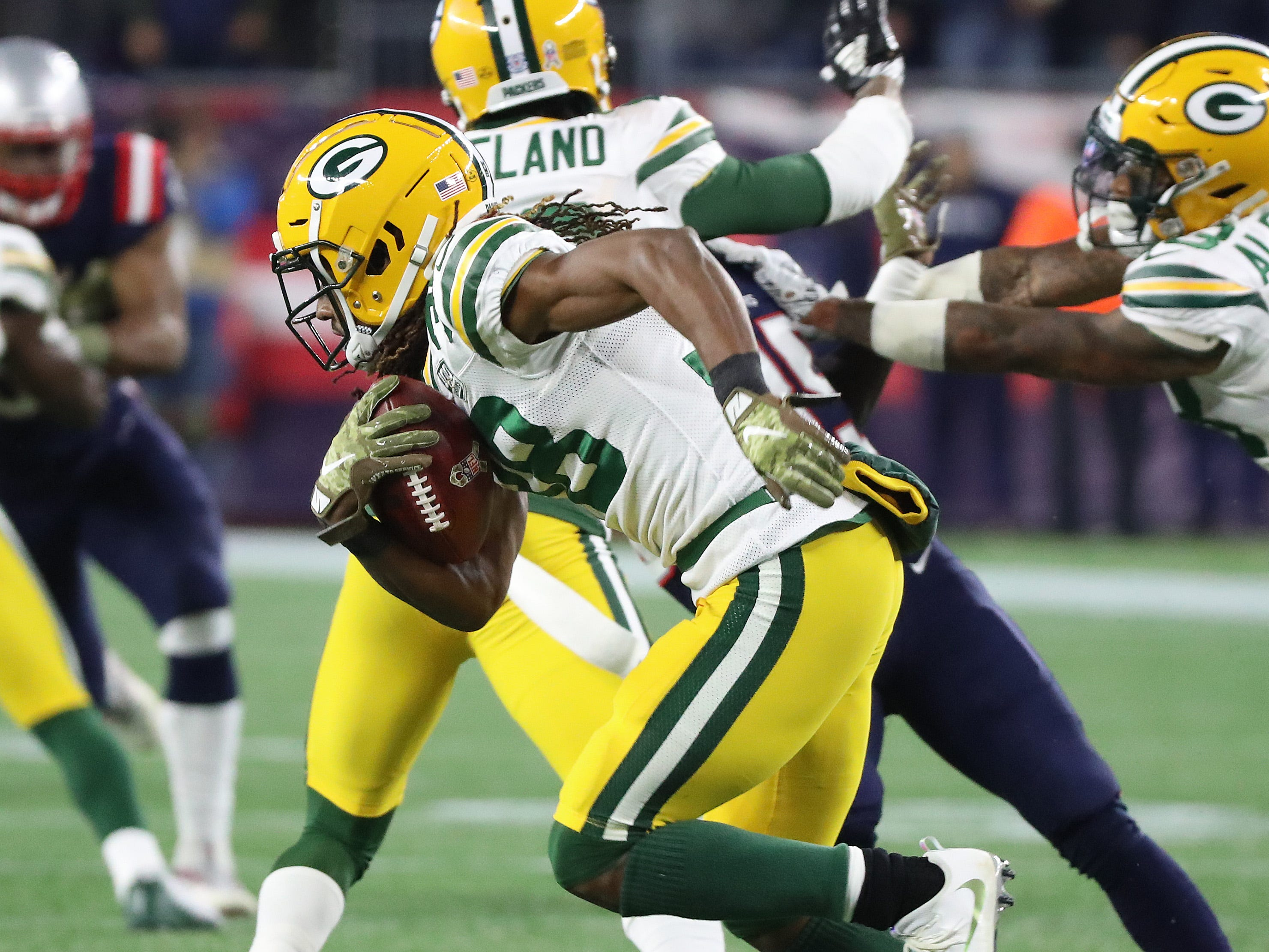 Green Bay Packers cornerback Tramon Williams (38) returns a punt against the New England Patriots Sunday, November 4, 2018 at Gillette Stadium in Foxborough, Mass.