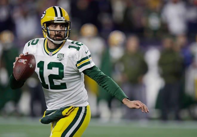Green Bay Packers quarterback Aaron Rodgers scrambles against the New England Patriots during the first half of an NFL football game, Sunday, Nov. 4, 2018, in Foxborough, Mass. (AP Photo/Charles Krupa)