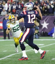 Green Bay Packers outside linebacker Clay Matthews (52) tries to pressure quarterback Tom Brady (12) against the New England Patriots Sunday, November 4, 2018 at Gillette Stadium in Foxboro, Mass.