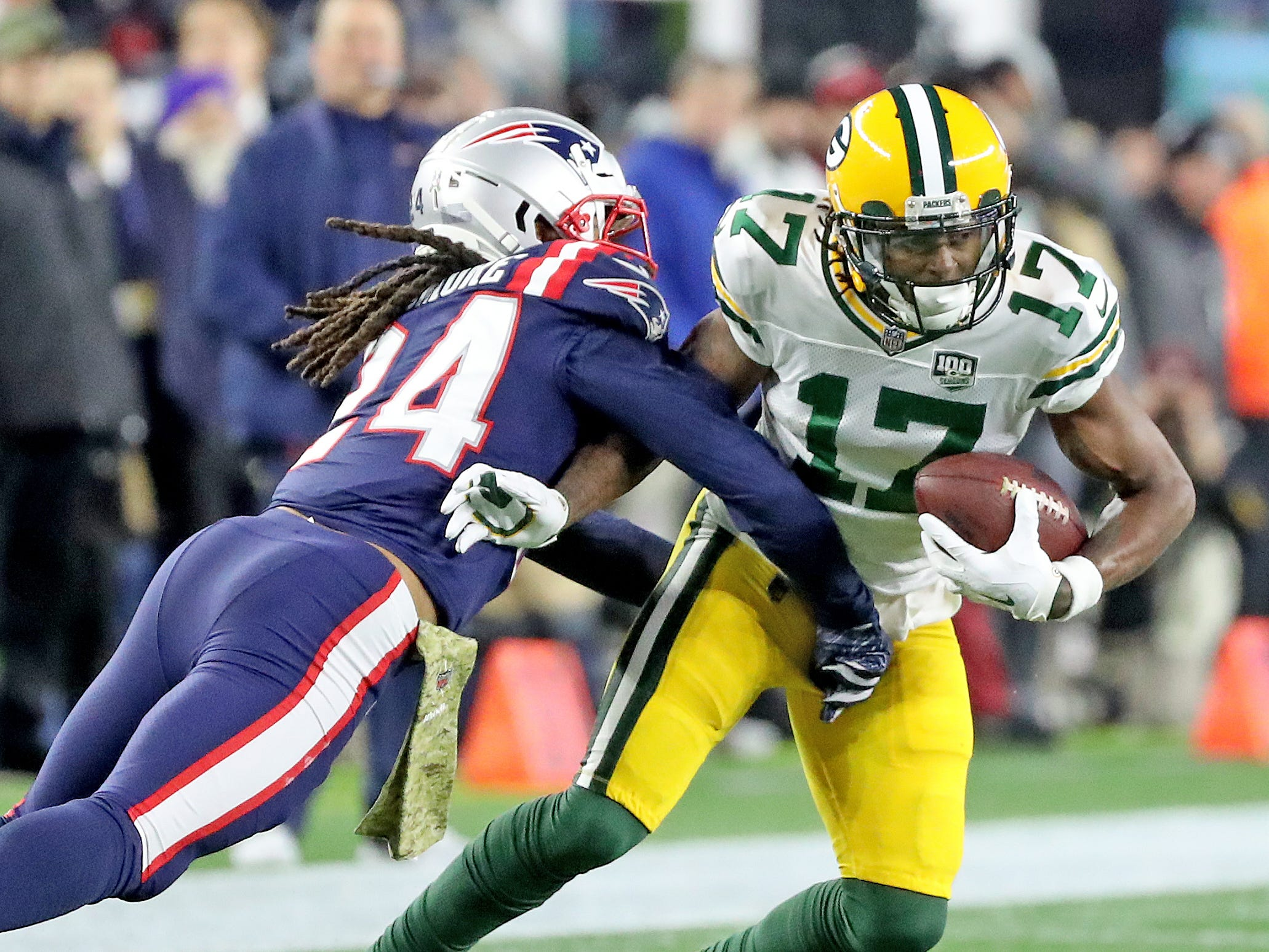 Green Bay Packers wide receiver Davante Adams (17) tries to move past cornerback Stephon Gilmore (24) after a reception against the New England Patriots Sunday, November 4, 2018 at Gillette Stadium in Foxborough, Mass.