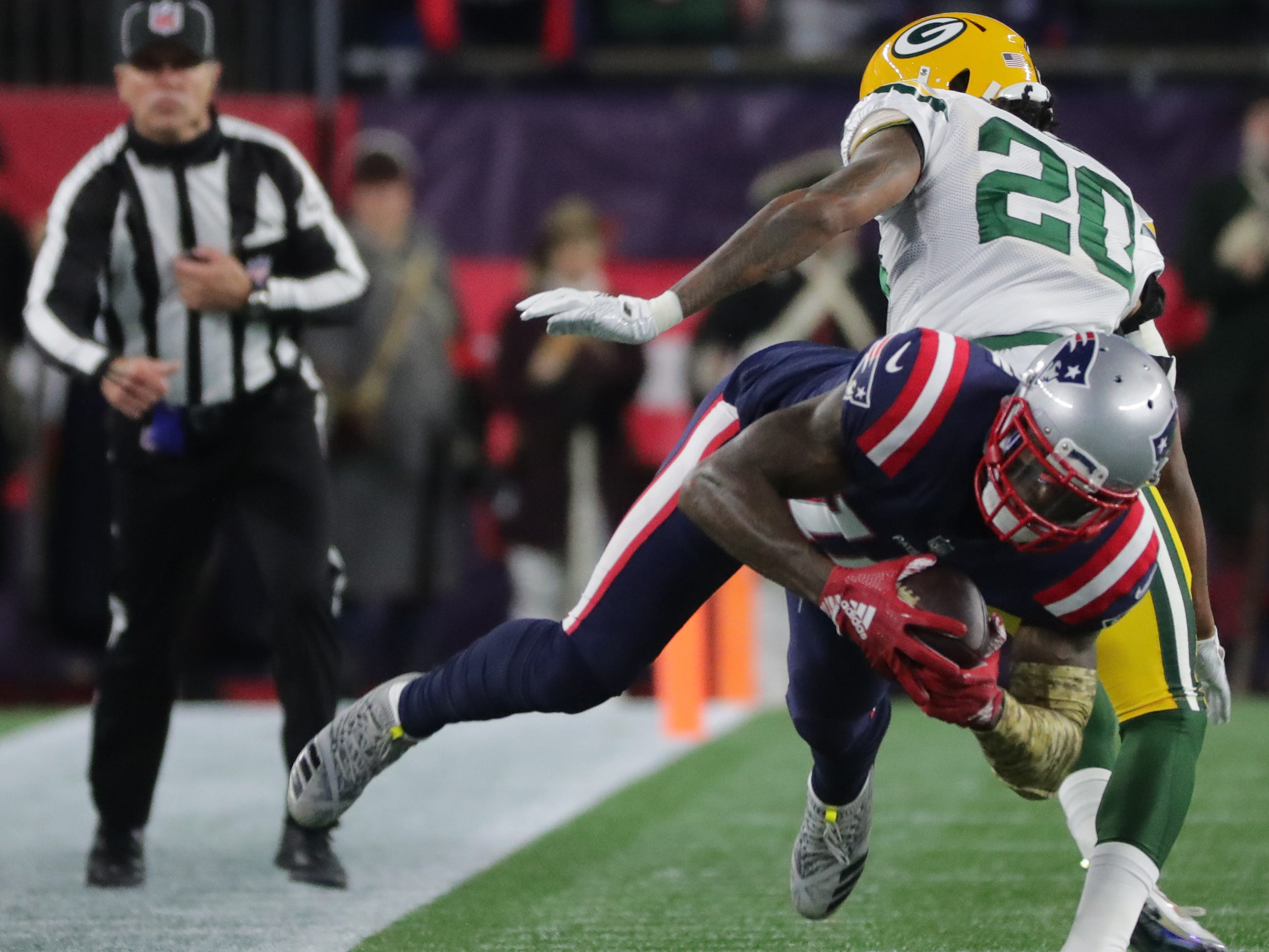 New England Patriots wide receiver Josh Gordon (10) is unable to stay inbounds for a completion while being covered by Green Bay Packers cornerback Kevin King (20) during the second quarter of their game Sunday, November 4, 2018 at Gillette Stadium in Foxborough, Mass.