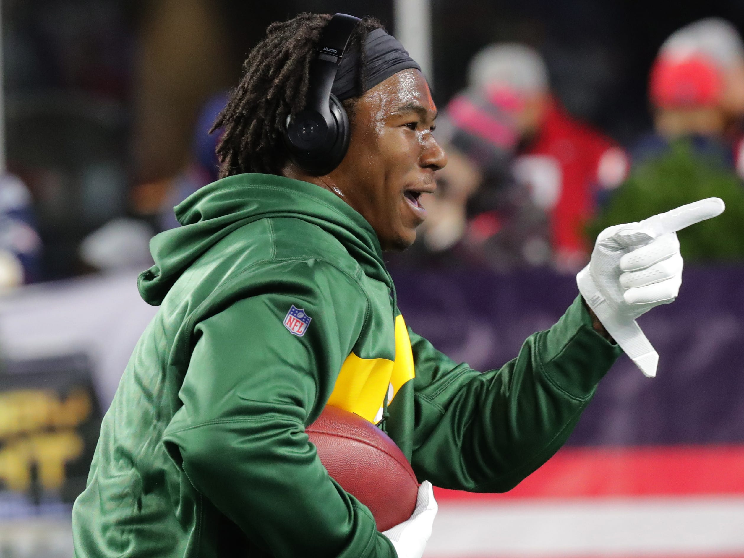 Green Bay Packers running back Jamaal Williams points to a Packers fan in the stands to play catch with before their game against the New England Patriots Sunday, November 4, 2018 at Gillette Stadium in Foxborough, Mass.