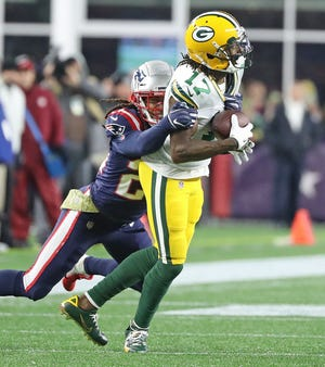 Green Bay Packers wide receiver Davante Adams (17) makes a catch against the New England Patriots Sunday, November 4, 2018 at Gillette Stadium in Foxborough, Mass.