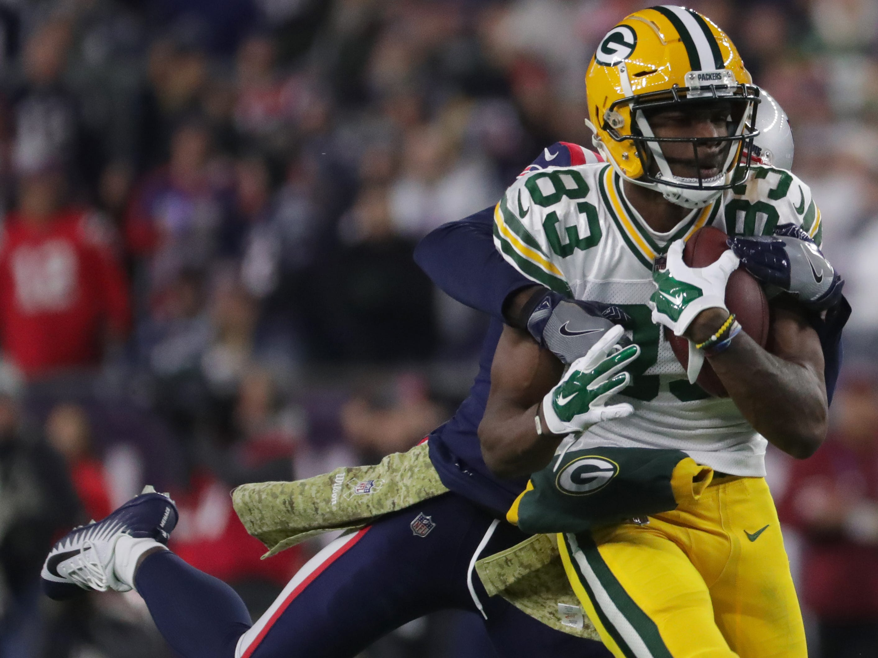 Green Bay Packers wide receiver Marquez Valdes-Scantling (83) is pursued New England Patriots linebacker Brandon King (36) while picking up 51 yards on a reception during the third quarter of their game Sunday, November 4, 2018 at Gillette Stadium in Foxborough, Mass. The New England Patriots beat the Green Bay Packers 31-17.