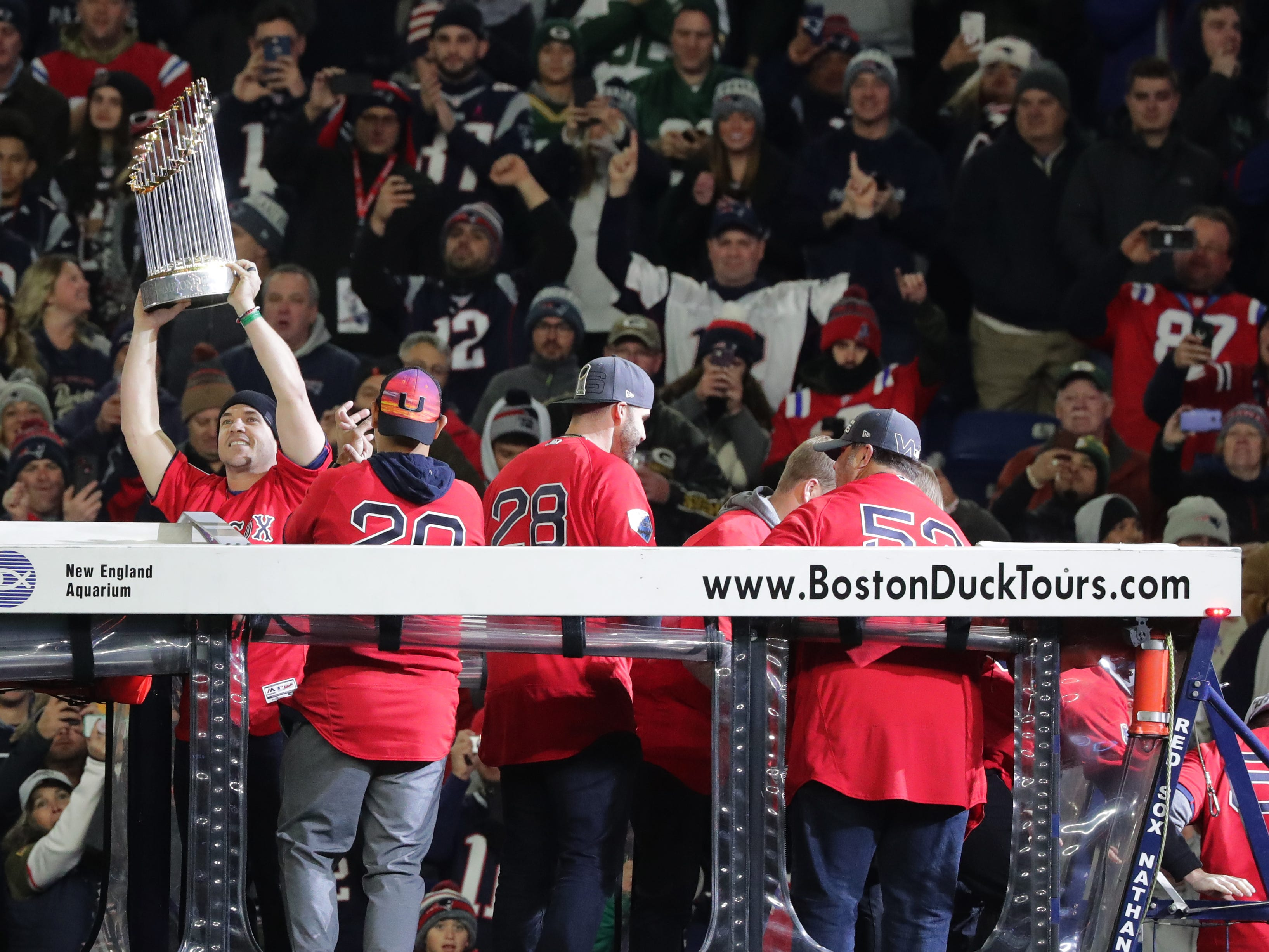 Members of the World Series winning Boston Red Sox entering carry their trophy before adoring fans before the New England Patriots game against the Green Bay Packers Sunday, November 4, 2018 at Gillette Stadium in Foxborough, Mass.