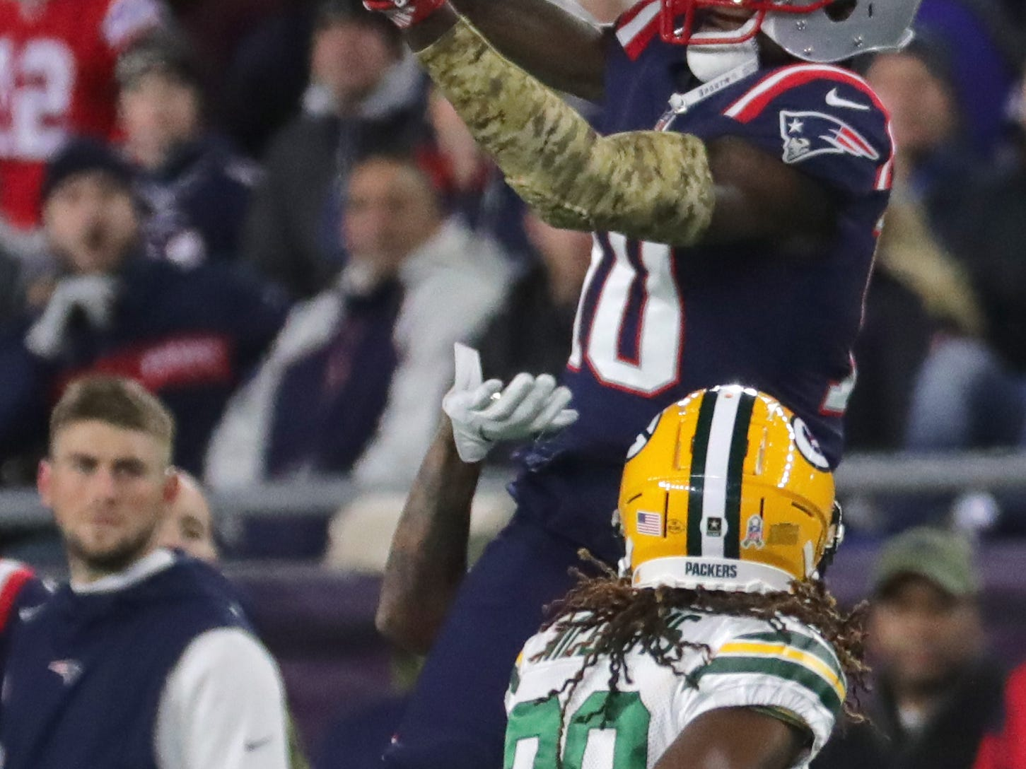 New England Patriots wide receiver Josh Gordon (10) reels in a 29-yard reception while being covered by Green Bay Packers cornerback Tramon Williams (38) during the second quarter of their game Sunday, November 4, 2018 at Gillette Stadium in Foxborough, Mass.