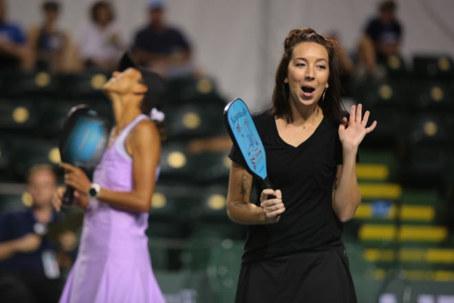 Nicole Hayden, right, reacts to a point with her partner Simone Jardim during the media challenge at the Margaritaville USA Pickleball National Championships, Sunday, November 4, 2018.