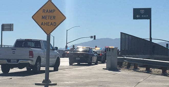 Police and California Highway Patrol officers are at the Monterey Avenue overpass, where a woman has threatened to jump onto Interstate 10. Traffic has been shut down on the freeway.