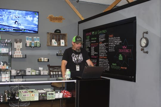 Chad Miller, Operations Manager at Leef Industries, works behind the dispensary counter. Leef Industries is one of the first four pot shops in the Coachella Valley to receive an annual retail cannabis license in California, according to the Bureau of Cannabis Control.