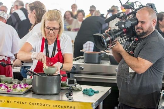 World Seafood Champion Kim Banick prepares her winning dish.
