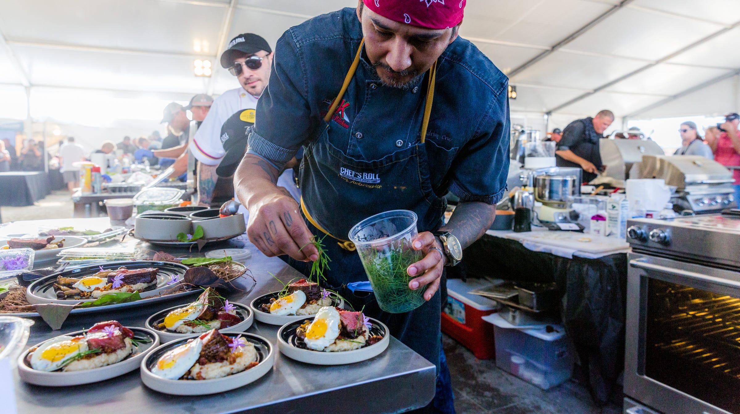 A competitor puts finishing garnish on his presentation dish at the 2017 World Food Championships.