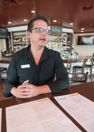 Lucas Moore, general manager and namesake of Lucas' Where Locals Go, talks Monday about the menu at the new restaurant at the Pensacola Beach Boardwalk Shopping Center.