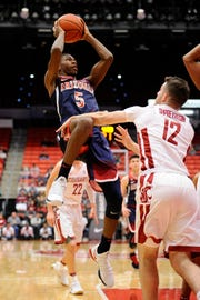 Arizona guard Brandon Randolph (5) shoots over Washington State guard Steven Shpreyregin (12) during the second half of a game Jan. 31.