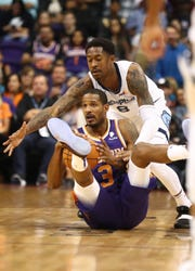 Nov 4, 2018; Phoenix, AZ, USA; Phoenix Suns forward Trevor Ariza (3) battles for a loose ball against Memphis Grizzlies guard MarShon Brooks (8) in the first half at Talking Stick Resort Arena.