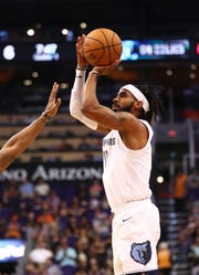 Nov 4, 2018; Phoenix, AZ, USA; Memphis Grizzlies guard Mike Conley (11) against the Phoenix Suns in the first half at Talking Stick Resort Arena. Mandatory Credit: Mark J. Rebilas-USA TODAY Sports