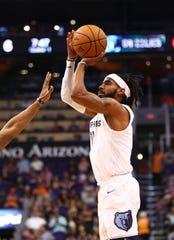 Nov 4, 2018; Phoenix, AZ, USA; Memphis Grizzlies guard Mike Conley (11) against the Phoenix Suns in the first half at Talking Stick Resort Arena. Mandatory Credit: Mark J. Rebilas-USA TODAY Sports