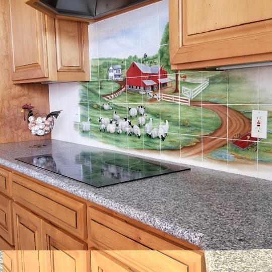 Custom tiled backsplash designed & fired onto ceramic tiles by artist Julia Hillman.