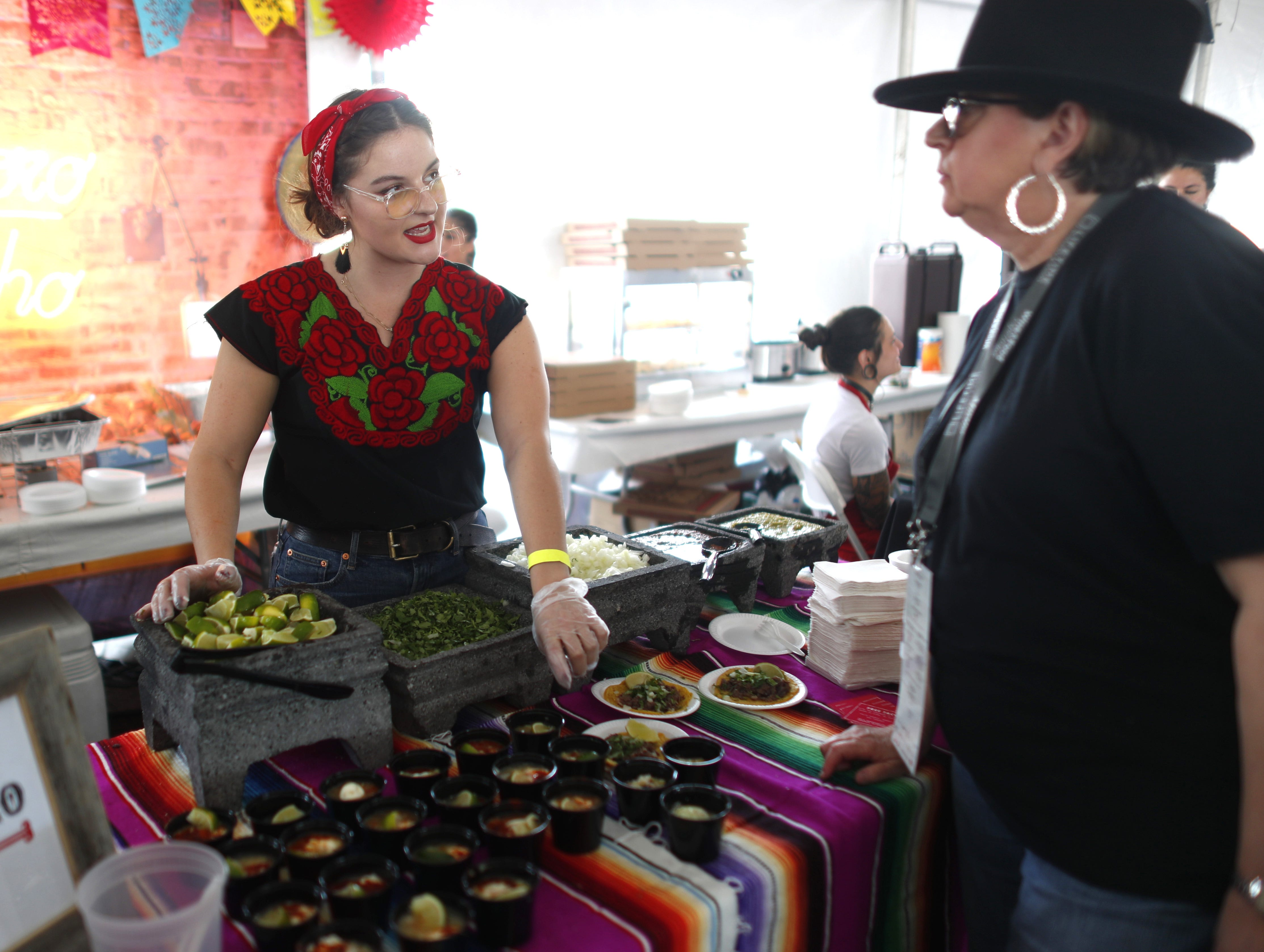 Amelia Goe serves food for Taco Chelo during the azcentral Wine & Food Experience at WestWorld of Scottsdale, Ariz. on Nov. 4, 2018.