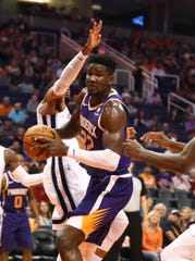 Nov 4, 2018; Phoenix, AZ, USA; Phoenix Suns center Deandre Ayton (22) controls the ball in the fourth quarter against the Memphis Grizzlies at Talking Stick Resort Arena.