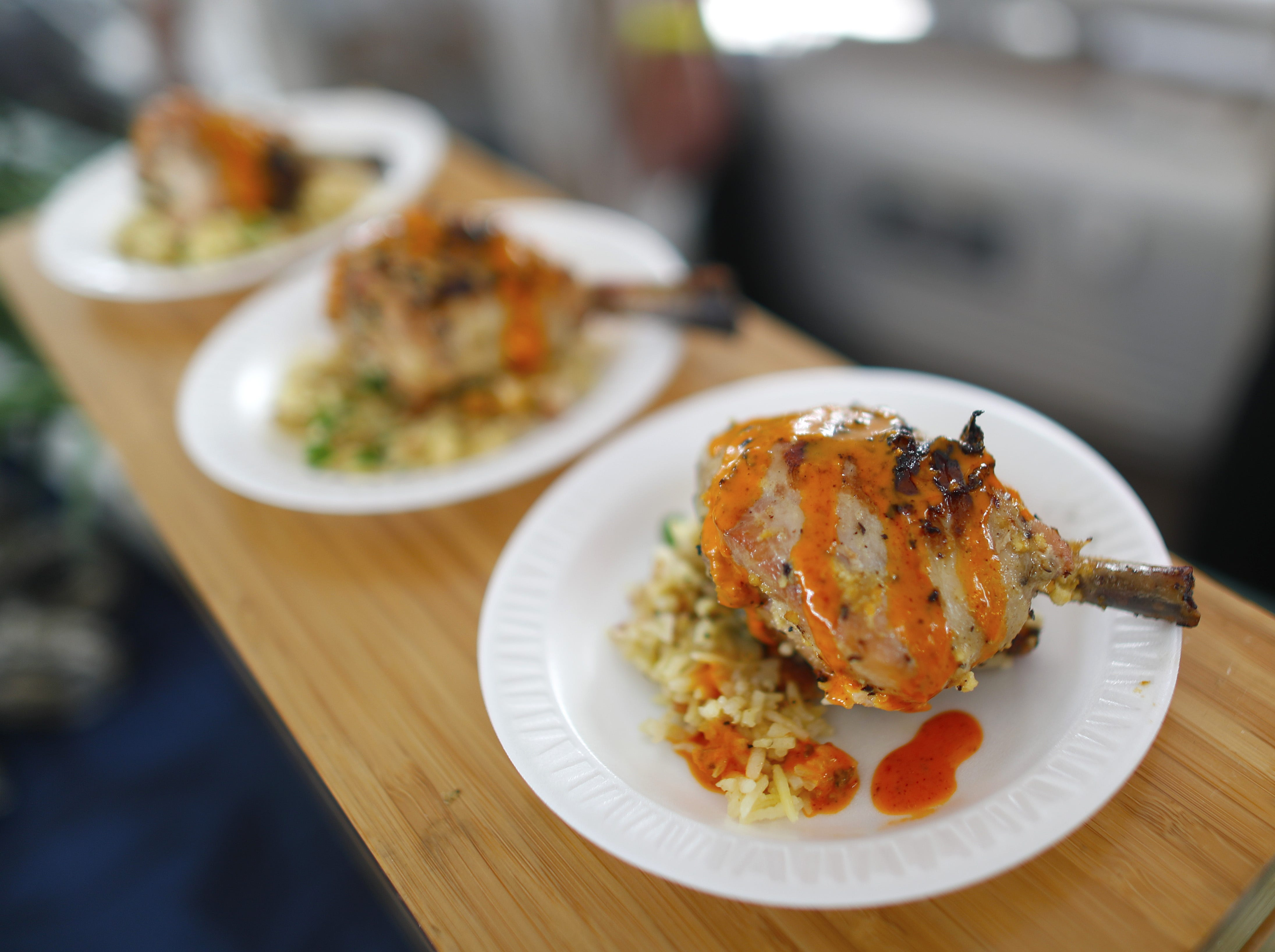 Mojo chicken with saffron plantain rice is displayed during the azcentral Wine & Food Experience at WestWorld of Scottsdale, Ariz. on Nov. 4, 2018.