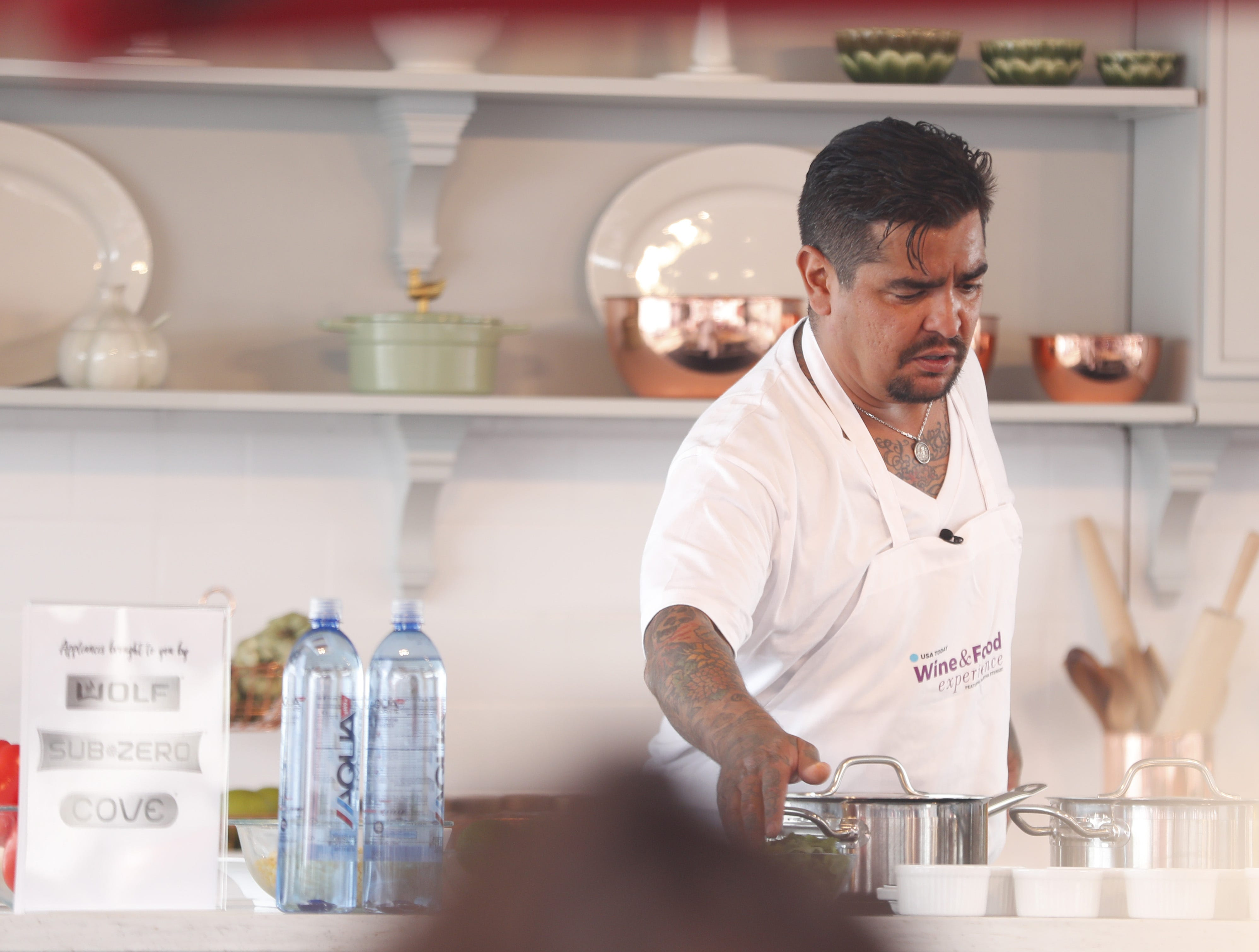 Chef Aarón Sánchez prepares a dish during the azcentral Wine & Food Experience at WestWorld of Scottsdale, Ariz. on Nov. 4, 2018.