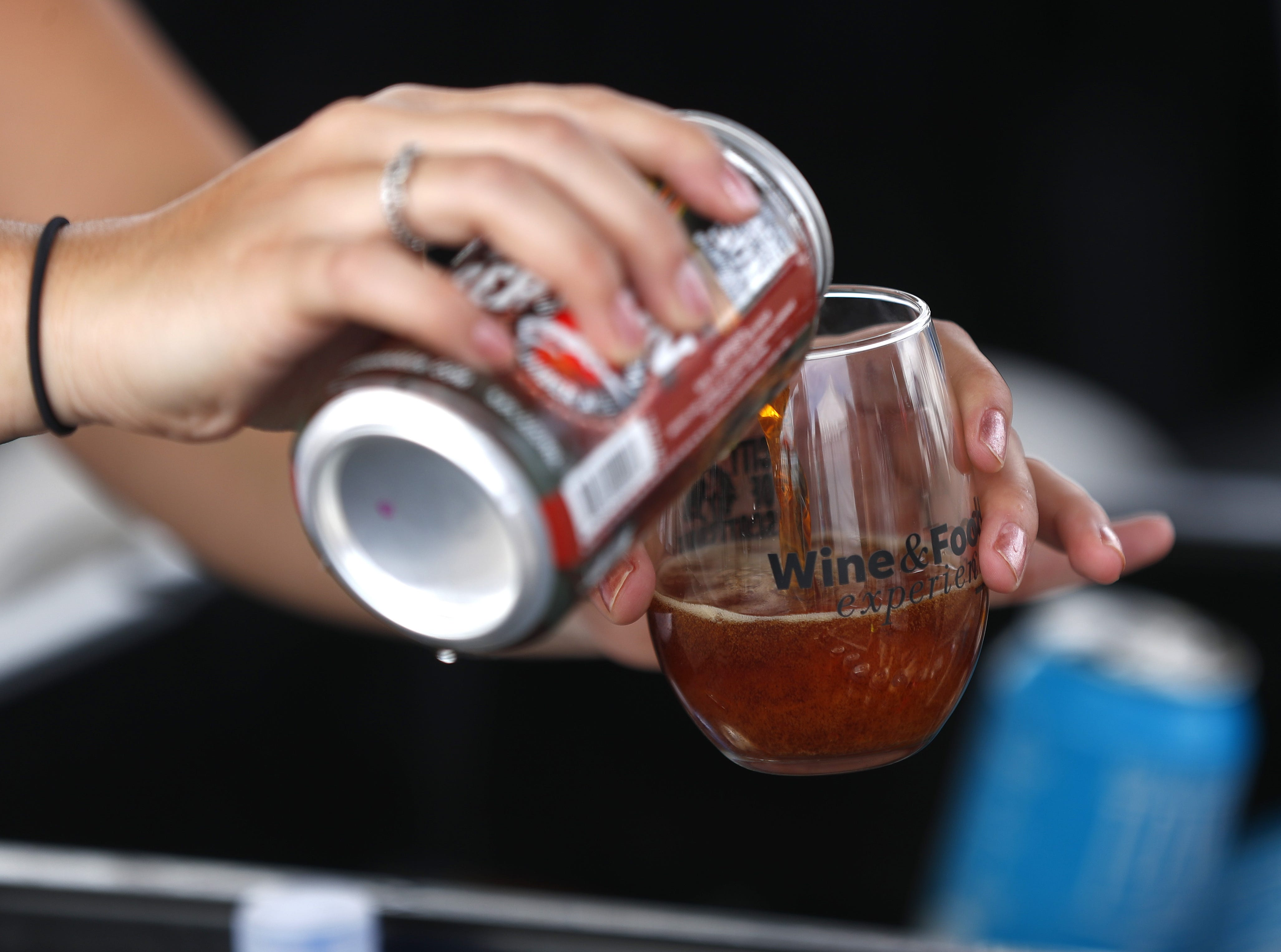 A beer is poured for a guest during the azcentral Wine & Food Experience at WestWorld of Scottsdale, Ariz. on Nov. 4, 2018.