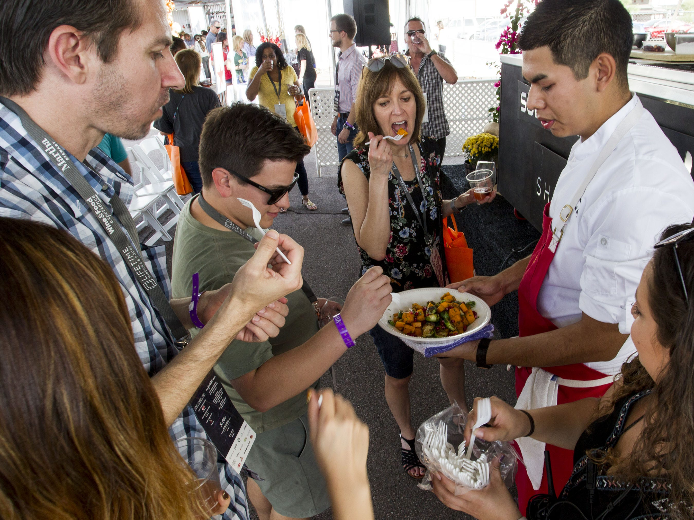 Guests try a sample of Chef David Brito's cooking during the azcentral Wine & Food Experience at WestWorld of Scottsdale, Sunday, Nov. 4, 2018.