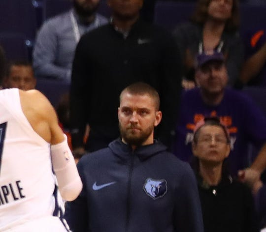 Memphis Grizzlies forward Chandler Parson watches from the bench as Phoenix Suns guard Devin Booker (1) shoots game winning jump shot in the closing seconds of the game against the Memphis Grizzlies at Talking Stick Resort Arena on Nov. 4. 2018: Mandatory Credit: Mark J. Rebilas-USA TODAY Sports