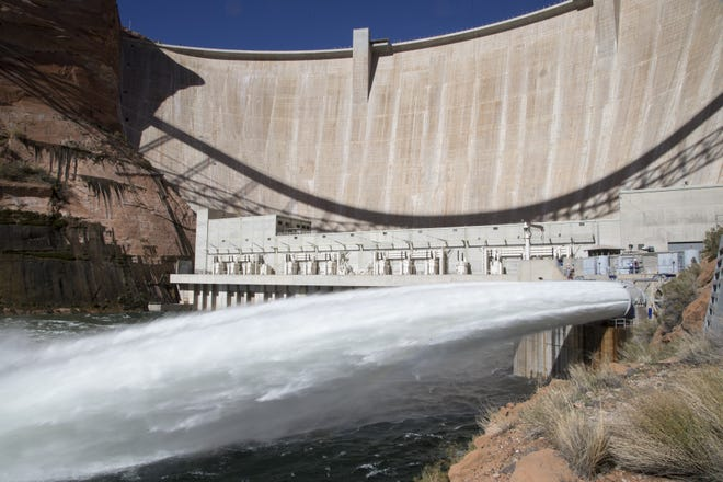 Water is released from Glen Canyon Dam through a bypass tube Nov. 5, 2018, during a high-flow experiment. The flood will help move sand and sediment down the Colorado River the way the river's natural flows did before construction of Glen Canyon Dam.