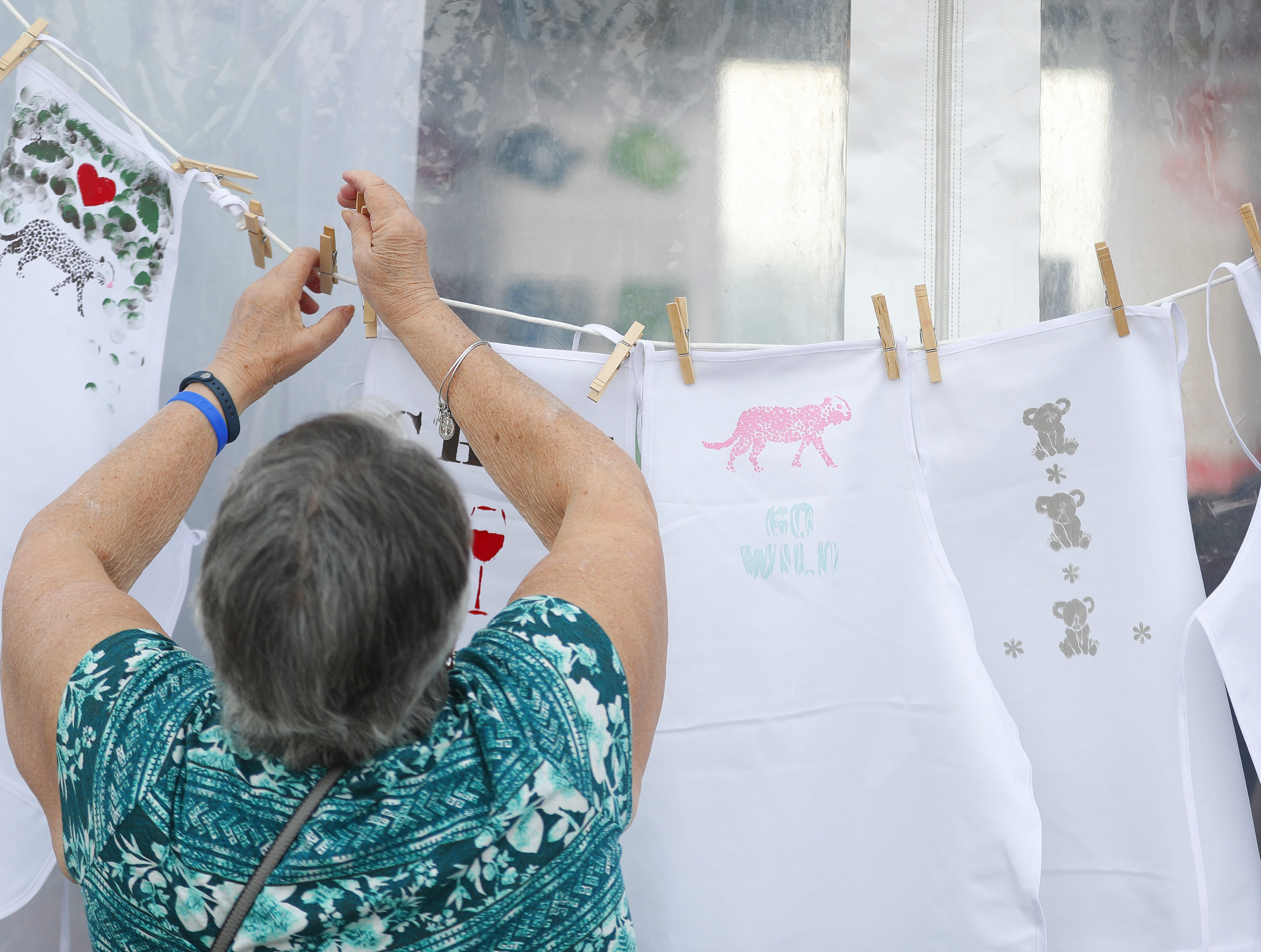 Aprons are hung to dry during the azcentral Wine & Food Experience at WestWorld of Scottsdale, Ariz. on Nov. 4, 2018.