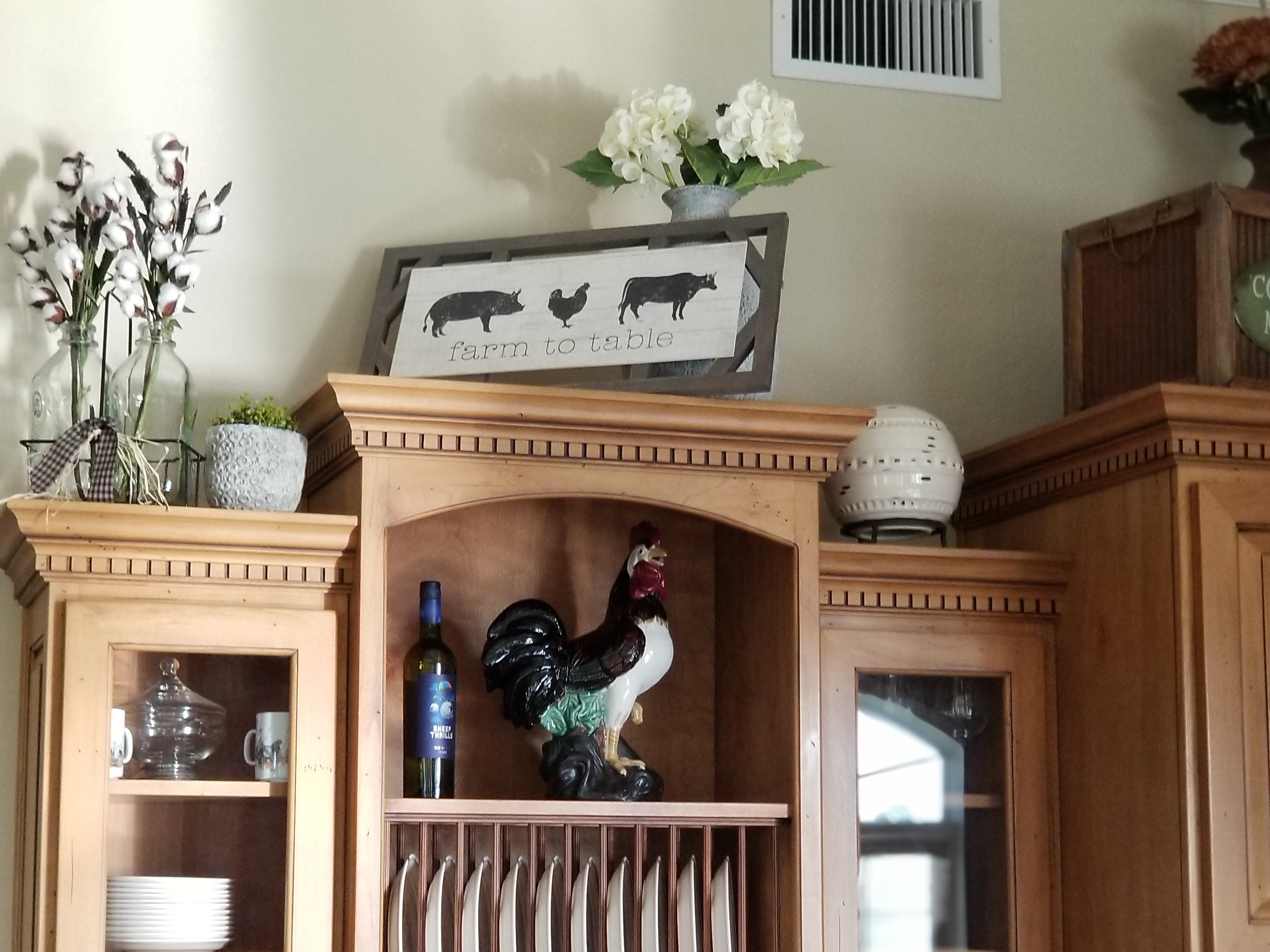 Tastefully placed farm life décor provides eye candy and a yearning for any visitor to want to live on a farm.