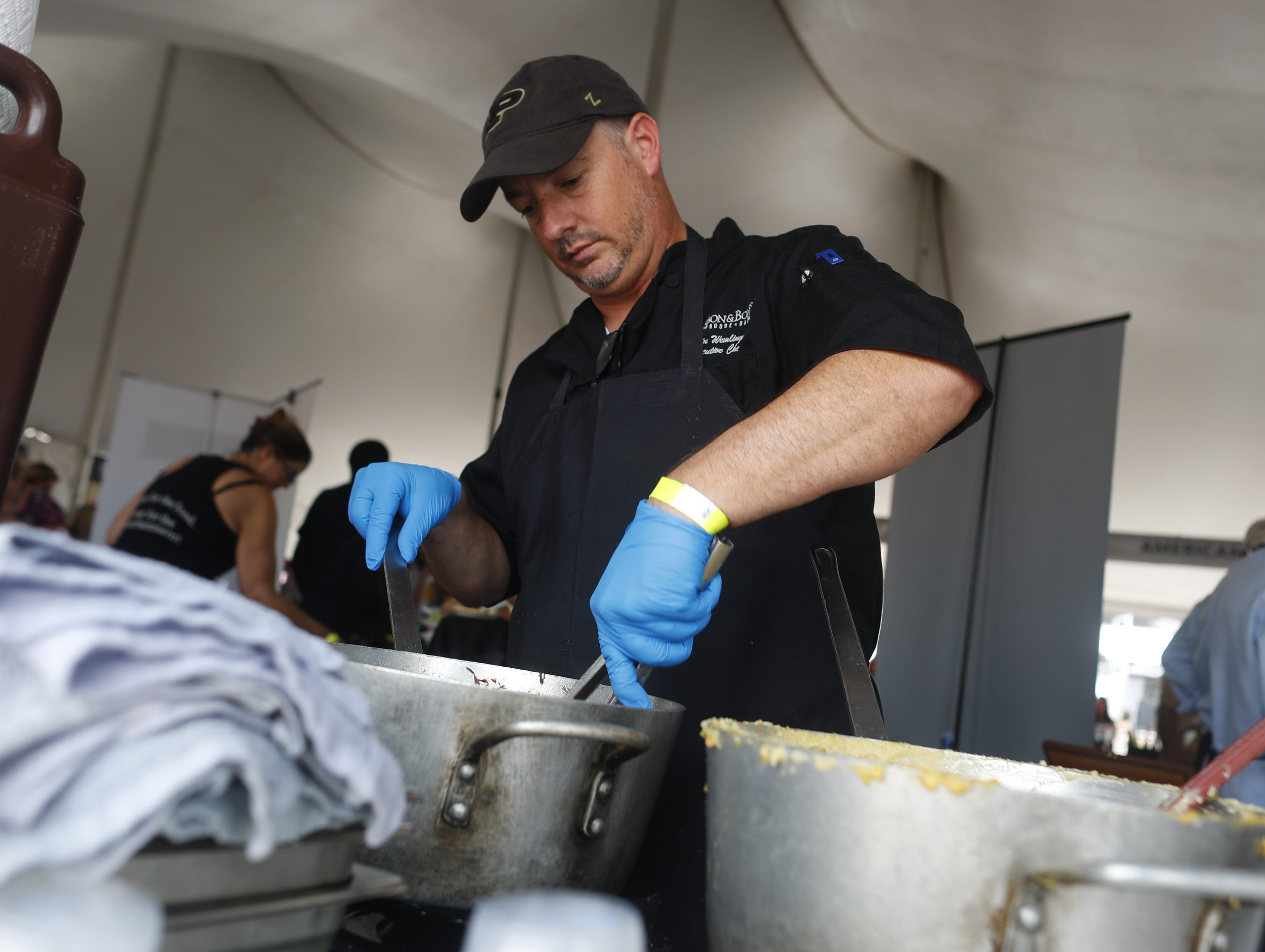 Head chef Kevin Wemlinger prepares some food during the azcentral Wine & Food Experience at WestWorld of Scottsdale, Ariz. on Nov. 4, 2018.