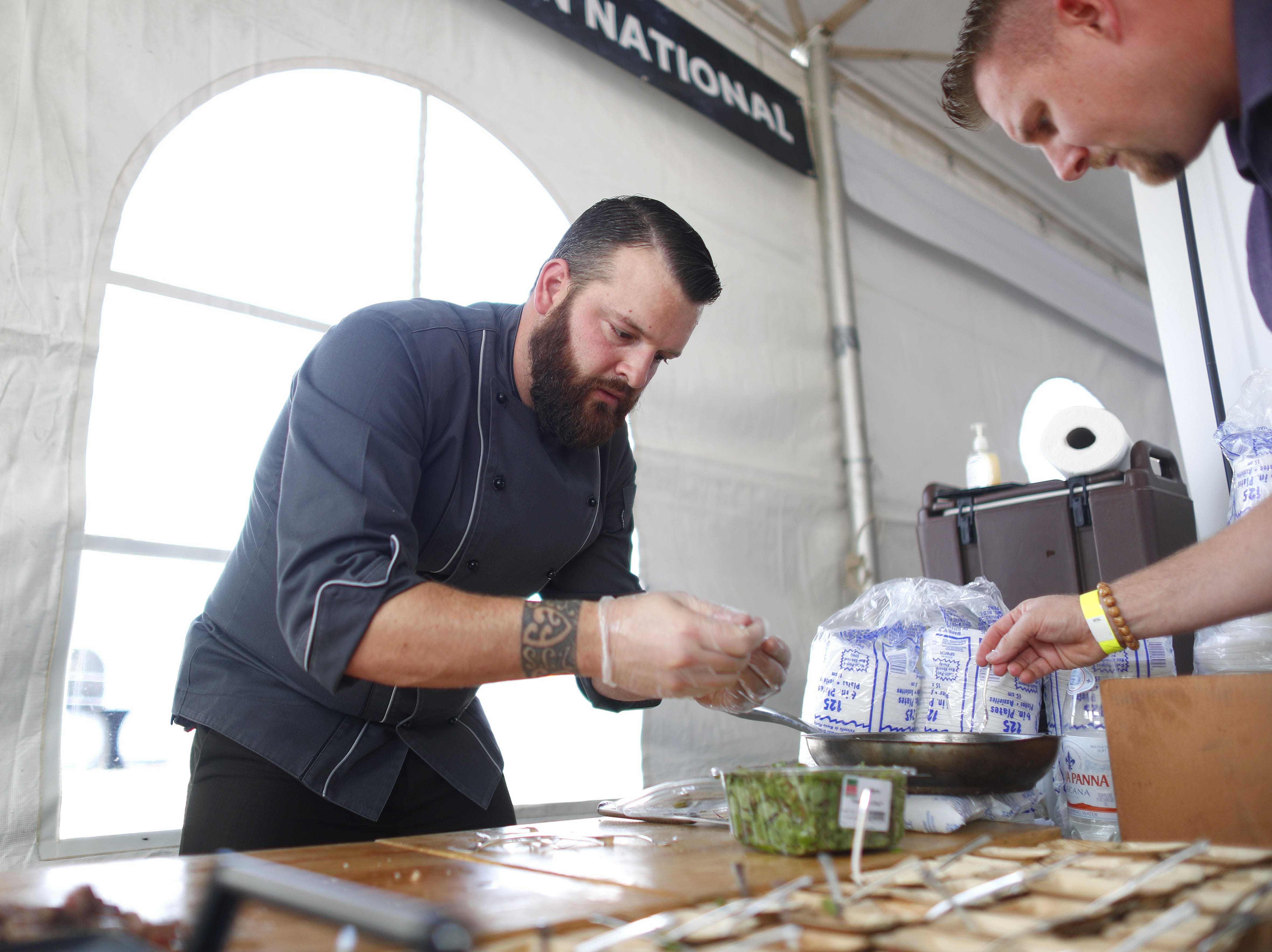 Executive chef Jonathan Stutzman puts the last touches on his Snowflake Wagyu Miyazaki Ribeye with smoke foie grass from Omni Hotels and Resorts bduring the azcentral Wine & Food Experience at WestWorld of Scottsdale, Ariz. on Nov. 3, 2018.