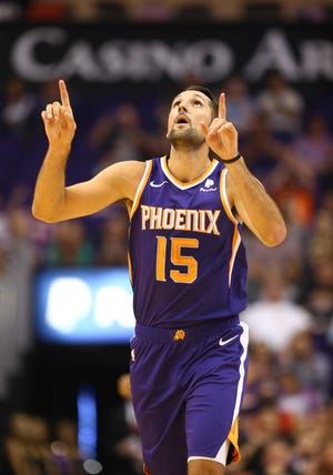 Nov 4, 2018; Phoenix, AZ, USA; Phoenix Suns forward Ryan Anderson (15) celebrates a three point shot against the Memphis Grizzlies at Talking Stick Resort Arena.
