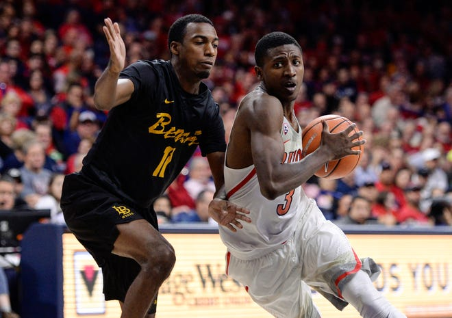 Arizona guard Dylan Smith drives to the basketbal against Long Beach State guard Jordan Griffin during the second half of a game last season at McKale Center.