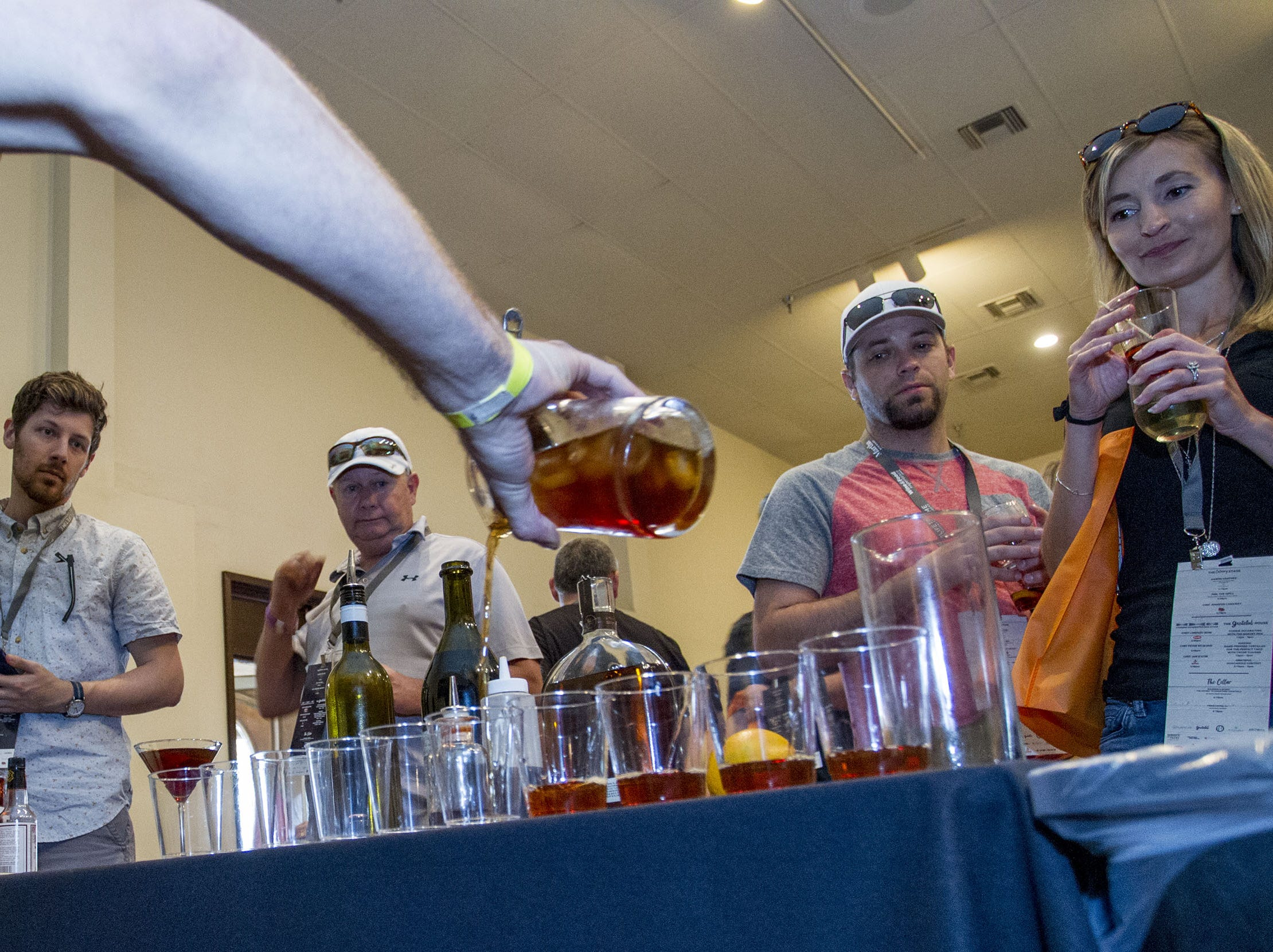 Mixologist Richie Moe makes a Bourbon & Bones Manhattan as guests wait for their sample during the azcentral Wine & Food Experience at WestWorld of Scottsdale, Sunday, Nov. 4, 2018.