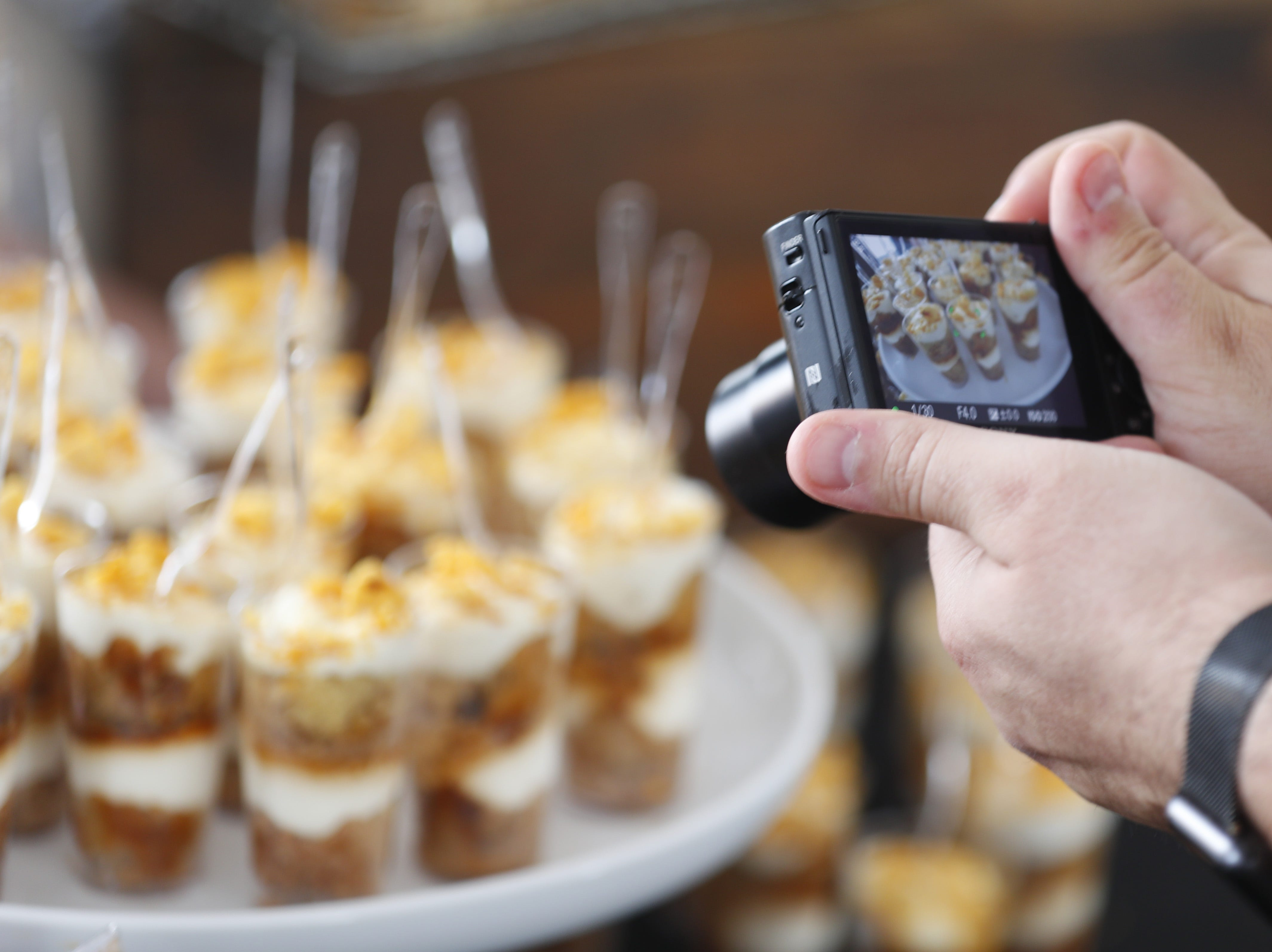 Arizona Republic food critic Dominic Armato takes a photo of Super Chunk Sweets during the azcentral Wine & Food Experience at WestWorld of Scottsdale, Ariz. on Nov. 4, 2018.