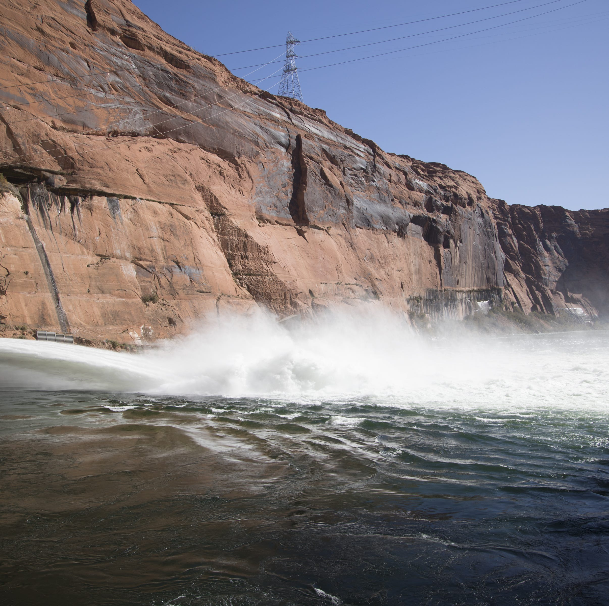 Water is released from Glen Canyon Dam through a bypass tube on Nov. 5, 2018, during a high-flow experiment. The flood will help move sand and sediment down the Colorado River the way the river's natural flows did before construction of Glen Canyon Dam.