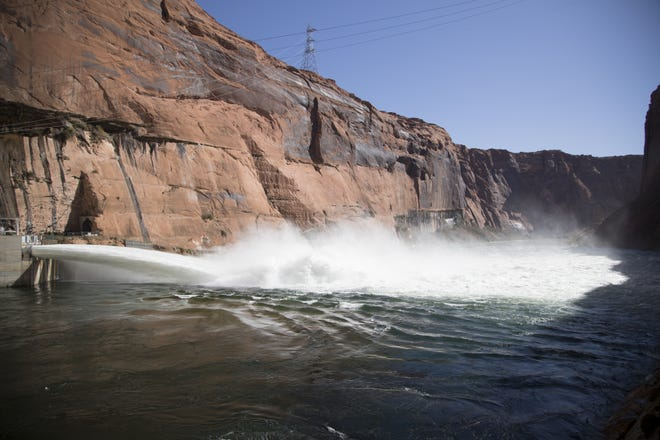 Water is released from Glen Canyon Dam through a bypass tube on Nov. 5, 2018, during a high-flow experiment. Officials say the move increased fish food, making for good fishing downriver.