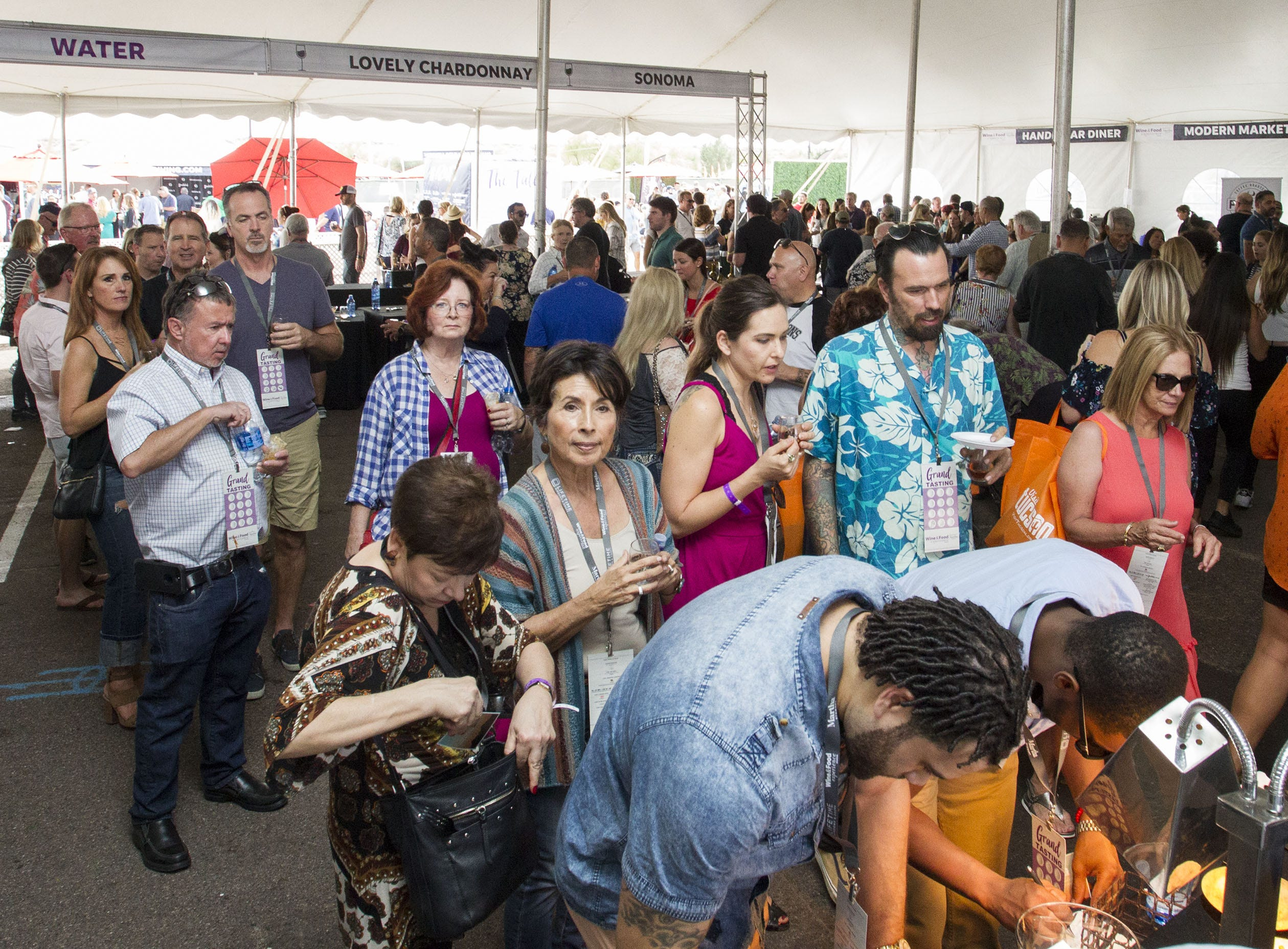 Wine & Food lovers wait in line for food samples during the azcentral Wine & Food Experience at WestWorld of Scottsdale, Sunday, Nov. 4, 2018.