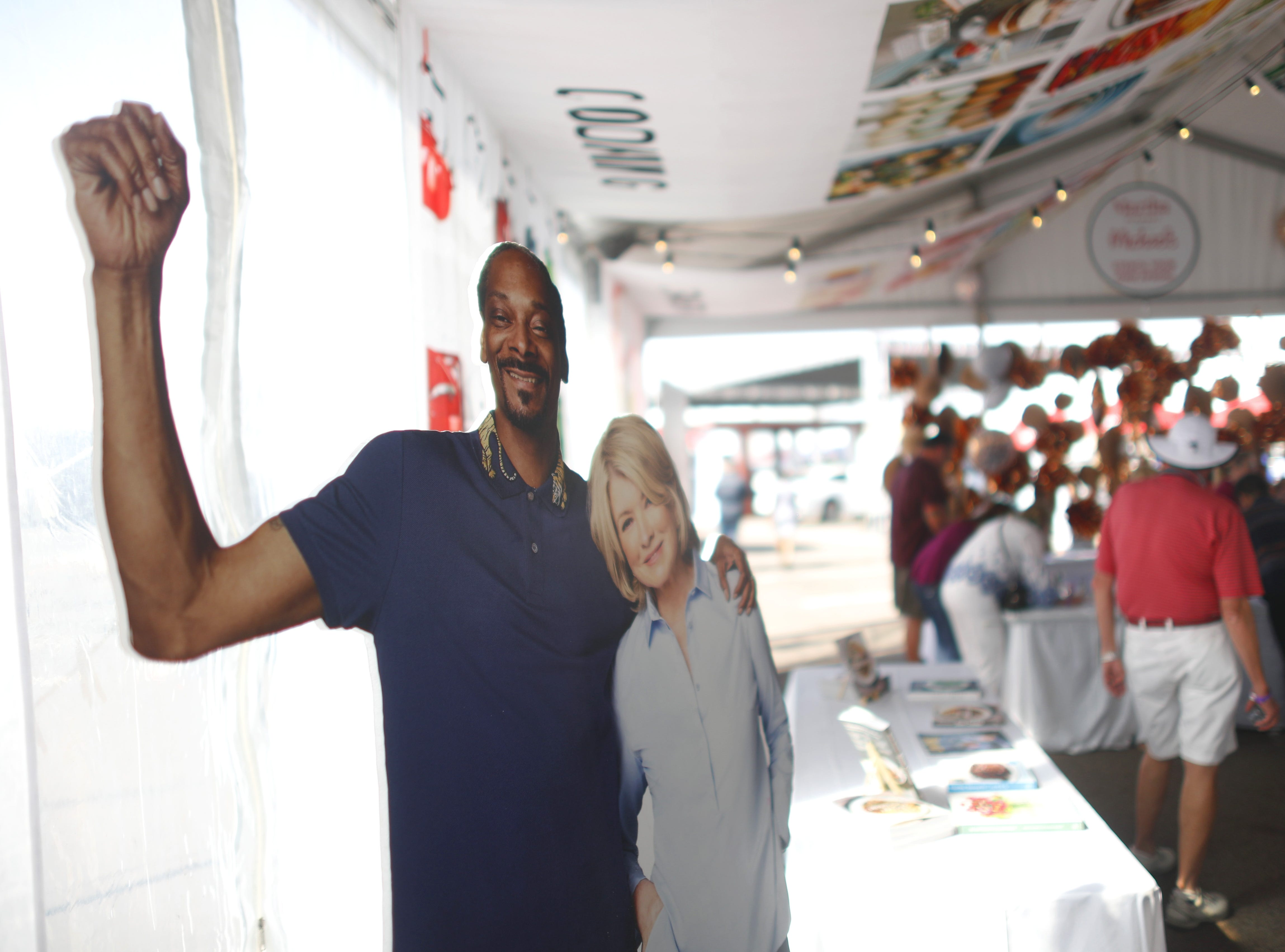 A poster of Martha Stewart and Snoop Dogg greet arrivals during the azcentral Wine & Food Experience at WestWorld of Scottsdale, Ariz. on Nov. 4, 2018.