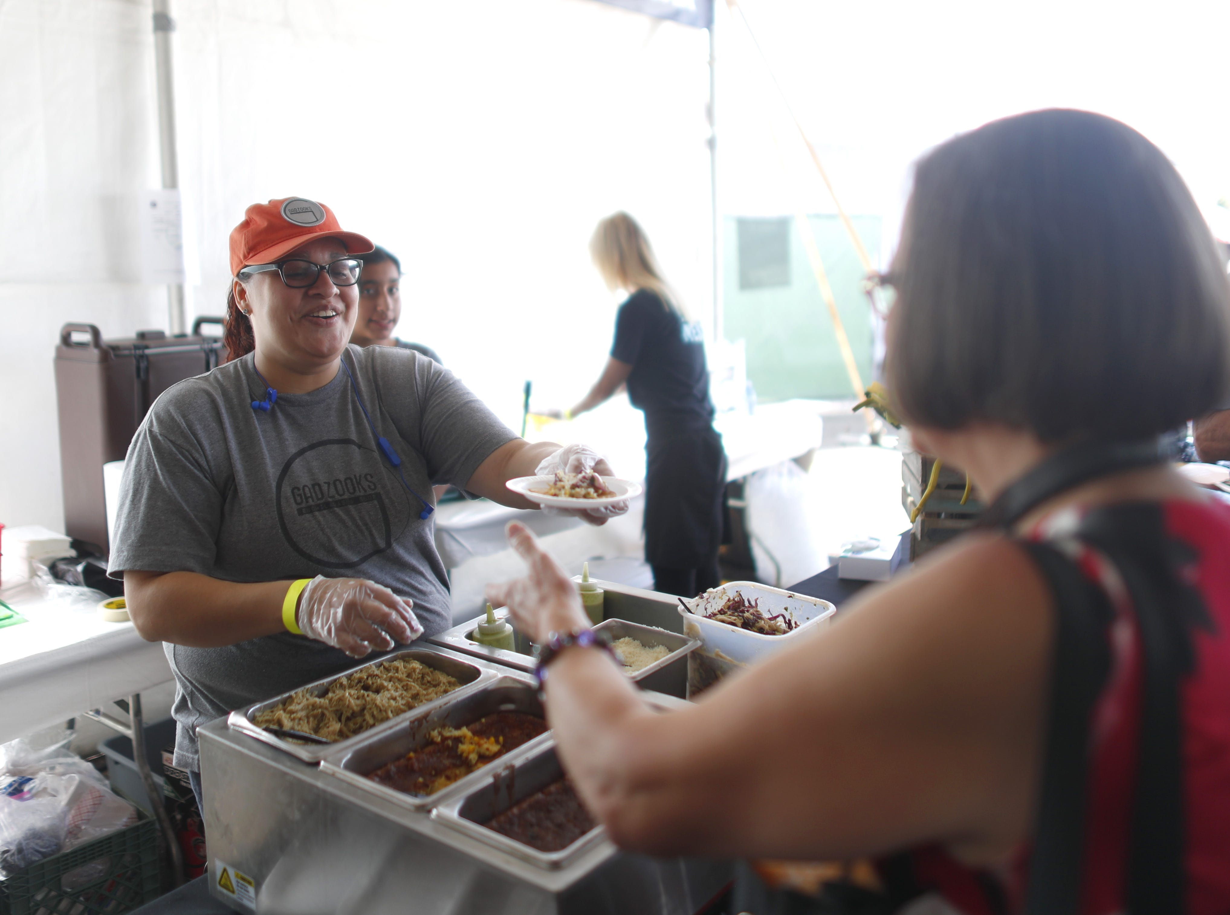 Food from Gadzooks is handed out during the azcentral Wine & Food Experience at WestWorld of Scottsdale, Ariz. on Nov. 4, 2018.