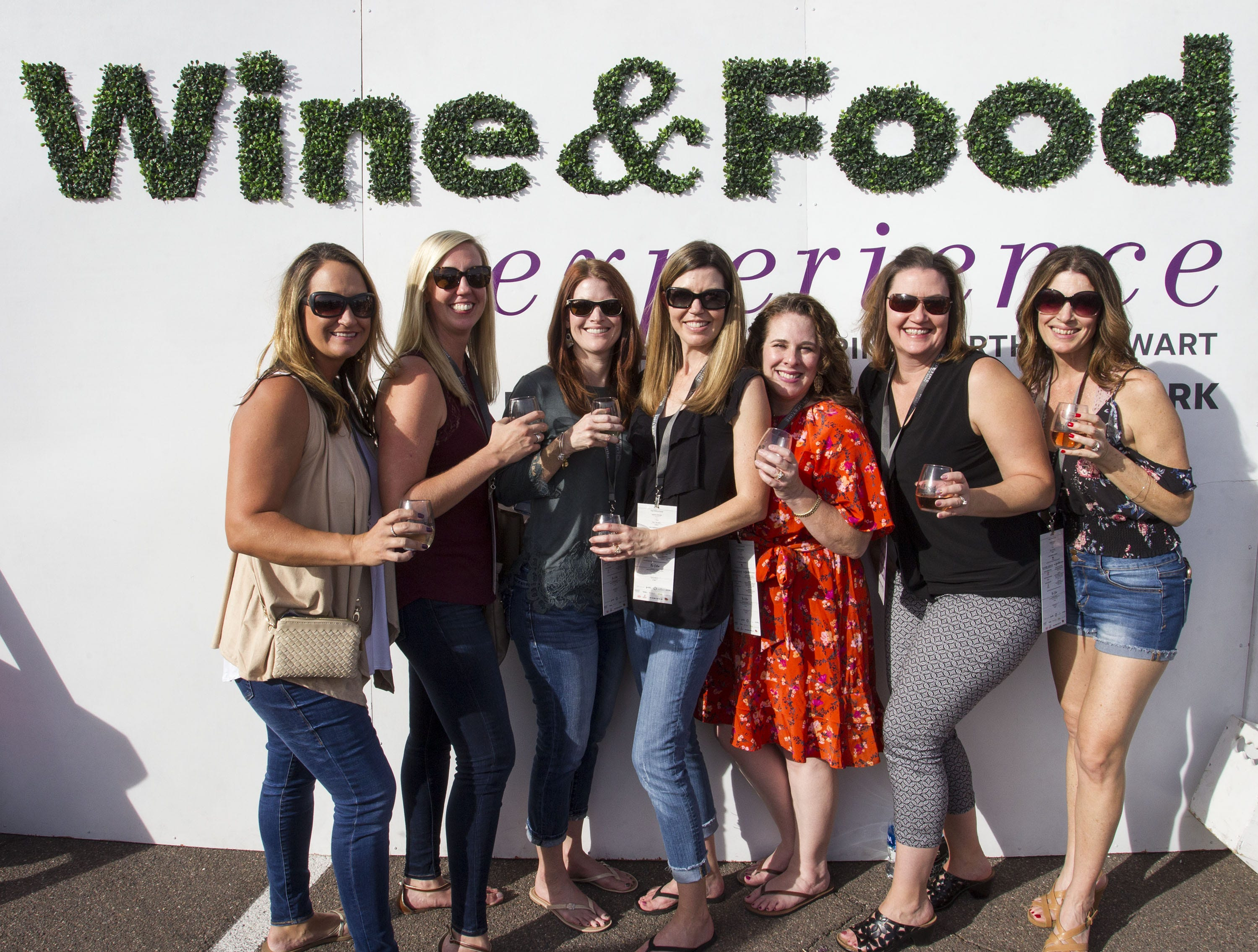 Wine and Food enthusiasts pose during the azcentral Wine & Food Experience at WestWorld of Scottsdale, Sunday, Nov. 4, 2018.