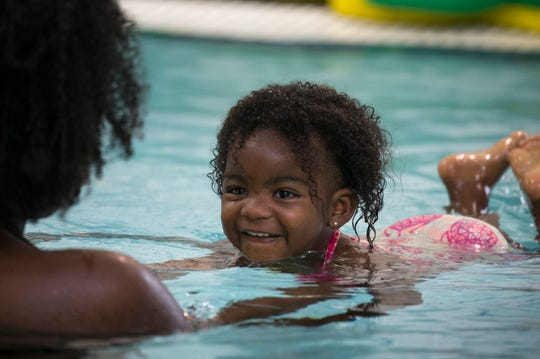 Brooke Adams works with her daughter, Tallulah Adams, 1, during Little Snapper swim lessons on Oct. 29, 2018, at Hubbard Family Swim School in Phoenix.