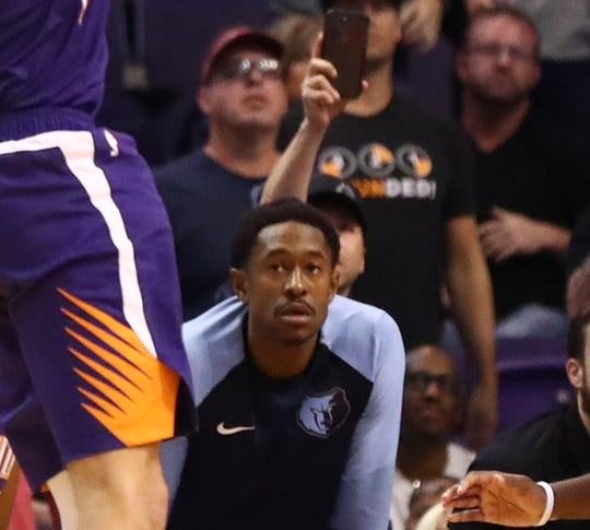Memphis Grizzlies forward MarShon Brooks looks on from the bench as he watches Phoenix Suns guard Devin Booker (1) shoots the go-ahead basket in the closing seconds of the fourth quarter to beat the Memphis Grizzlies at Talking Stick Resort Arena. Mandatory Credit: Mark J. Rebilas-USA TODAY Sports