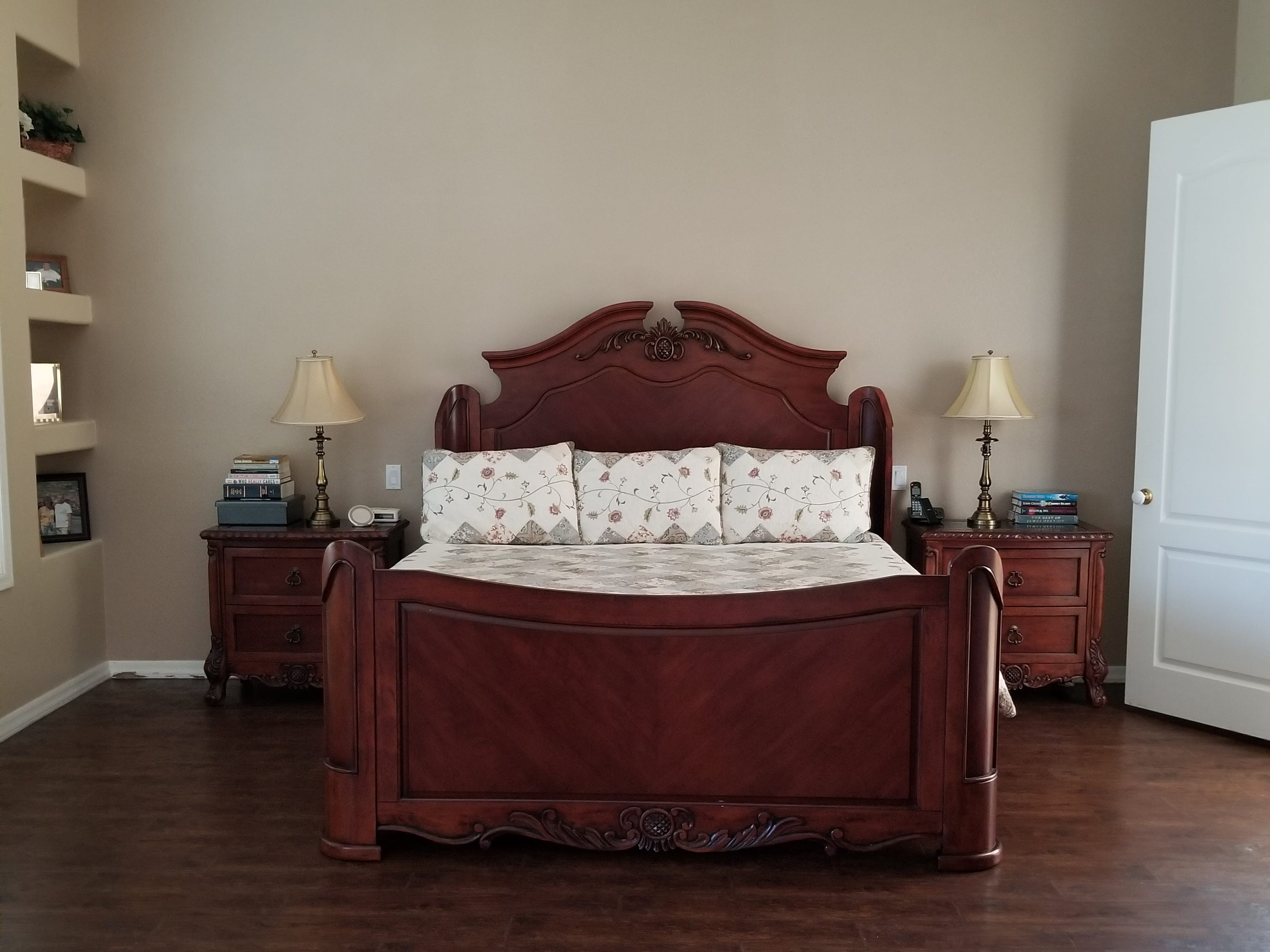 A built-in recess left of bed holds cherished family photos while two wing chair recliners complete a sitting area at the opposite end of the room. Plank Vinyl wood simulated flooring gives the look of hardwoods without the special care, and are resistant to scratches from the family pack of four-leggers.